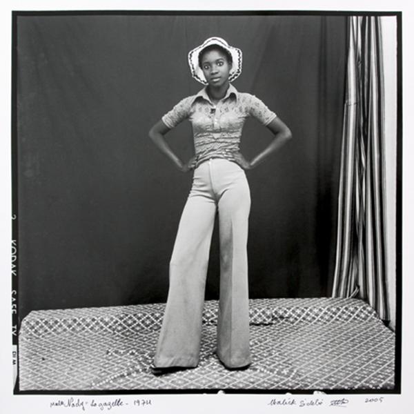MALICK SIDIBÉ<br/>Gazelle - my hat and bell bottoms, 1974/2006, silver gelantine print, 50 x 60 cm