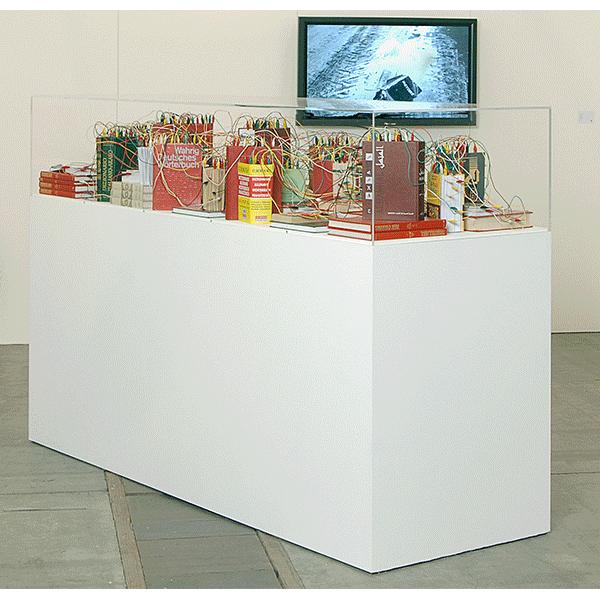 mounir fatmi<br/>Connection/Translation, 2009, books, cable under plexiglas cover on plint