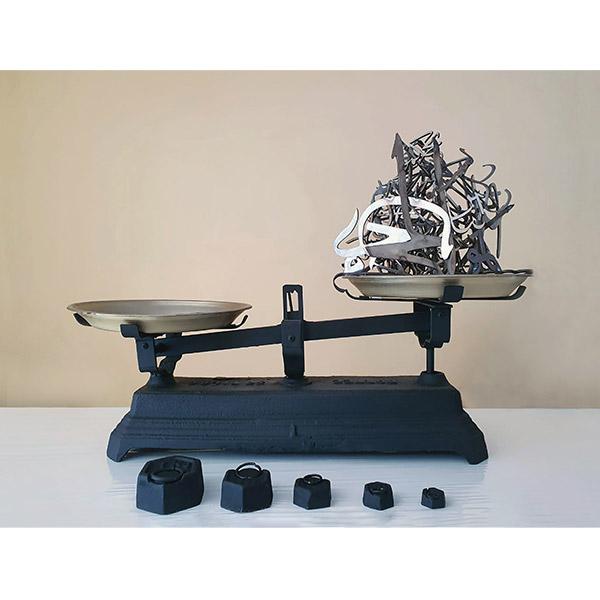 mounir fatmi<br/>Heavier Than Words, 2020, cast iron balance, arabic calligraphies of steel